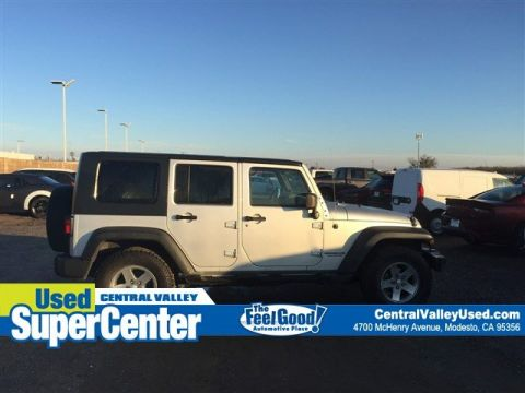 Pre-Owned 2010 Jeep Wrangler Unlimited Islander